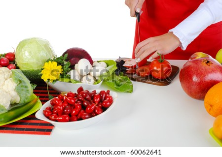 Chef cuts the tomato. Isolated on white background - stock photo