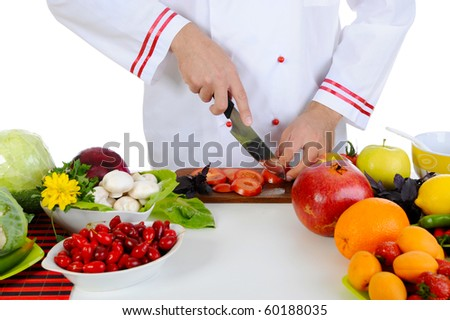 Chef cuts the vegetables. Isolated on white background - stock photo