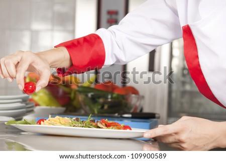 chef decorating - stock photo