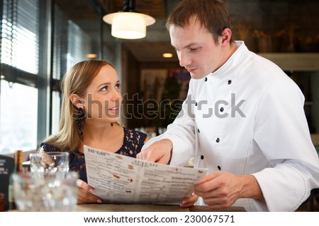 Chef discussing the menu with guest - stock photo