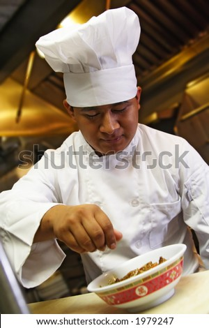 chef do finishing touch on chinese food - stock photo