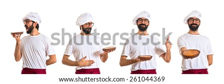 Chef eating a cake - stock photo