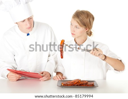 chef examining cook, cooks team in white uniforms preparing meat, series - stock photo