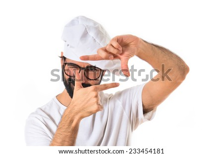 Chef focusing with his fingers - stock photo