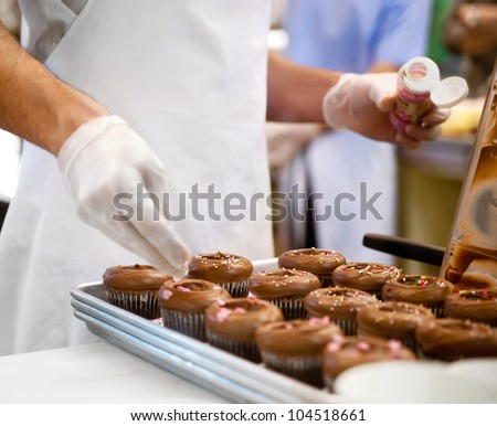 Chef hands cooking sweet dessert at cafe - stock photo