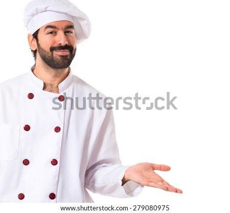 Chef having doubts over white background - stock photo