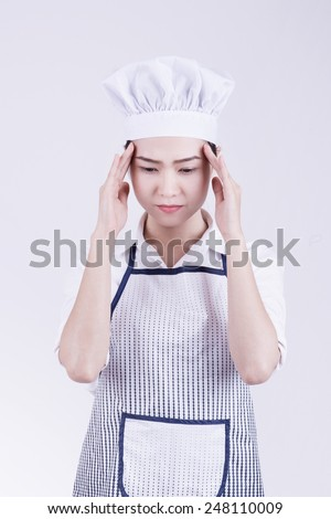 Chef headache and stress at work. Woman baker, chef or cook tired stressed and overworked with stress. - stock photo