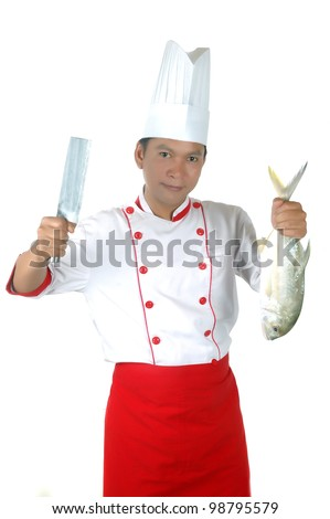 chef holding a big raw fish and kitchen knife isolated on white background - stock photo