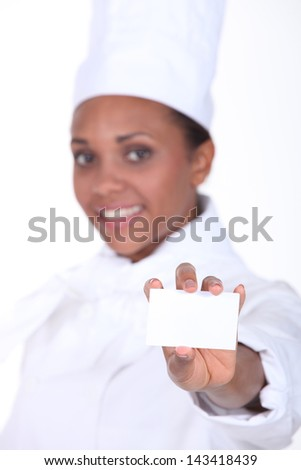 Chef holding a businesscard - stock photo
