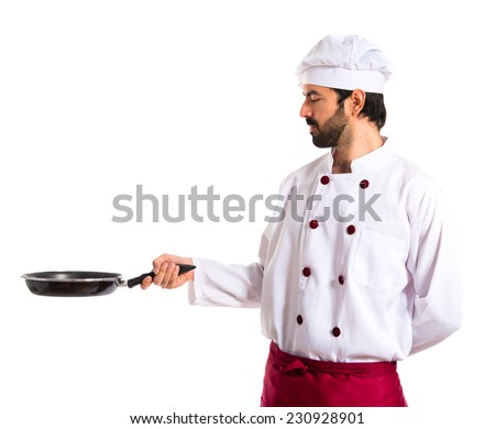 Chef holding frying pan - stock photo