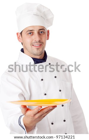 Chef holding plate with something. Isolated over white.