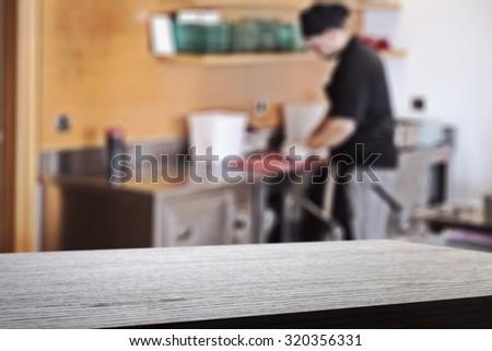 chef in kitchen interior  - stock photo