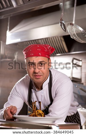 chef in the kitchen at the restaurant for cooking corporate cuisine - stock photo