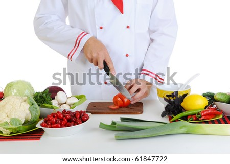 Chef in uniform cuts the vegetables. Isolated on white background - stock photo