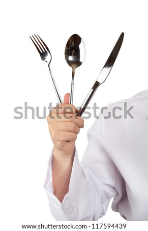 Chef In Uniform With a Knife, Spoon And Fork In Hand; Isolated On White Background (with clipping patch) - stock photo