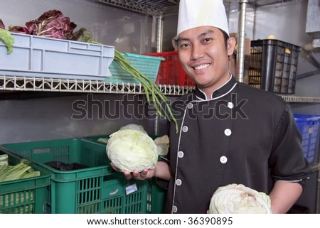 chef in vegetable storage - stock photo