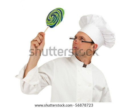 chef in white uniform and hat keeping colourful lollipop