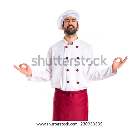 Chef in zen position over white background - stock photo