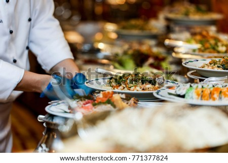 Chef arranging food on buffet table stock photo royalty free chef arranging food on buffet table stock photo royalty free 771377824 shutterstock watchthetrailerfo