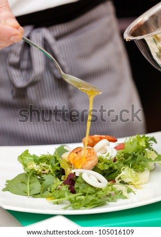 Chef is decorating appetizer - stock photo