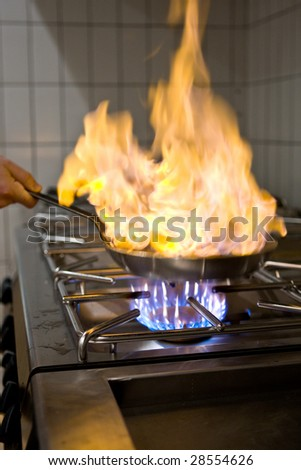 Chef is preparing a flambe dish