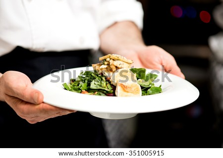 Chef is ready to serve roast goat cheese - stock photo