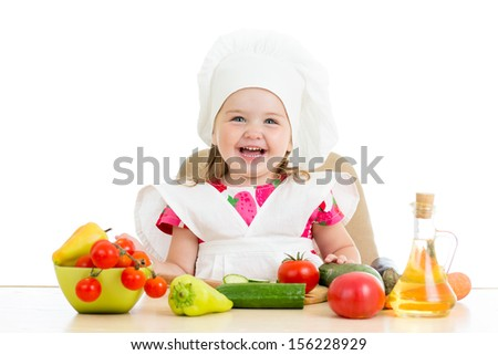 Chef kid preparing healthy food - stock photo