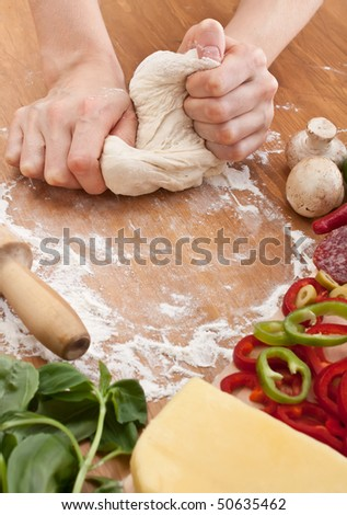 Chef Kneading Dough for Pizza - stock photo