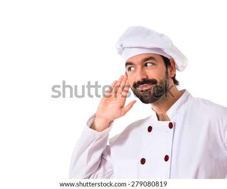 Chef listening over white background - stock photo