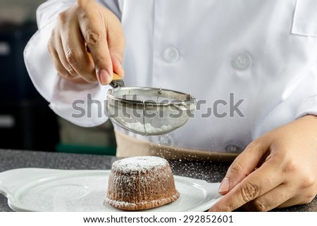 chef making lava chocolate cake in the kitchen - stock photo