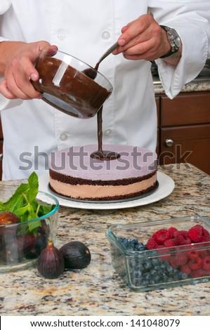 chef making mousse cake - stock photo