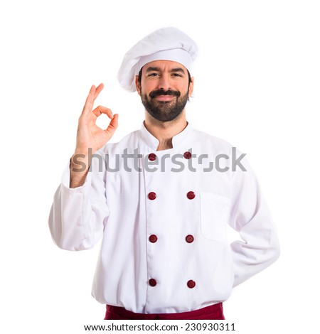 Chef making Ok sign over white background - stock photo