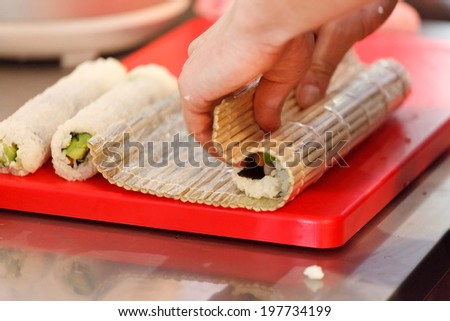 chef making sushi - stock photo