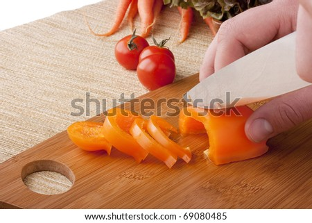 Chef Man cut vegetables on kitchen blackboard. - stock photo