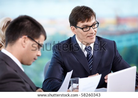 Chef oversees the work of their subordinates - stock photo