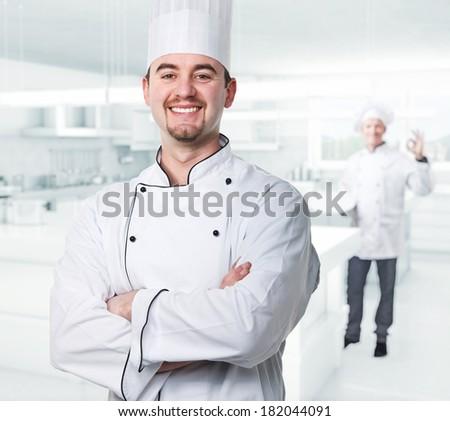 chef portrait and kitchen background - stock photo