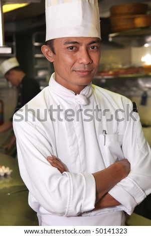 chef pose at work - stock photo