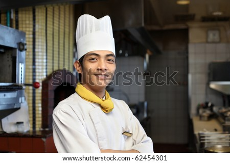 chef posing in the kitchen - stock photo