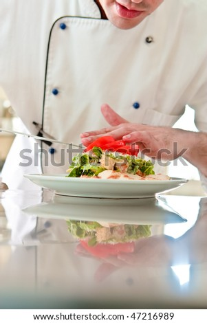 Chef prepare Caesar salad - stock photo