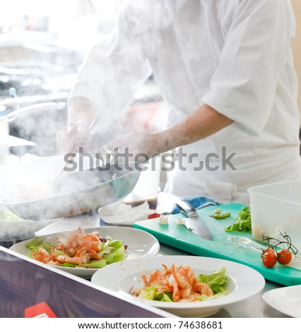 Chef preparing food - stock photo