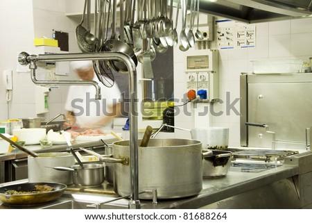 Chef preparing food  in kitchen restaurant - stock photo
