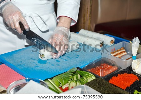 chef preparing sushi in the kitchen