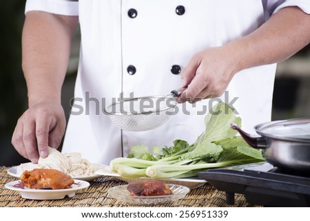 Chef present noodle with noodle soup ingredient / Cooking Noodle concept - stock photo