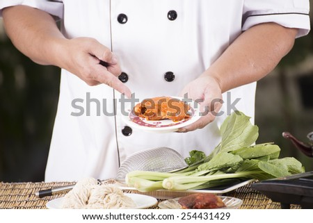 Chef present roasted chicken with noodle ingredient / Cooking Noodle concept  - stock photo