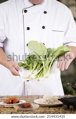Chef present vegetable with noodle ingredient / Cooking Noodle concept  - stock photo
