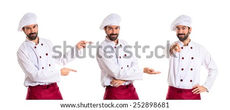 Chef presenting something over white background - stock photo