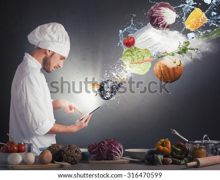 Chef reads a recipe from the tablet