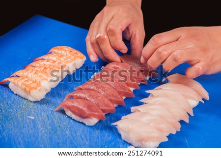 chef ready to prepare japanese sushi rolls - stock photo