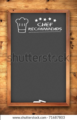 chef recommends chalkboard on wooden background - stock photo