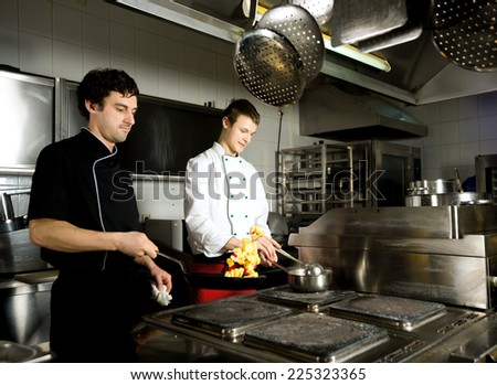 chef restaurant keeps food for hotel guests/chef restauran - stock photo